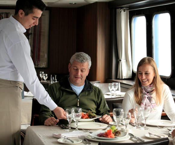 People dining, passengers eating on Ventus Australis Patagonian cruise ship, Patagonia