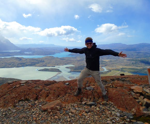 Man bracing the wind at the Mirador Ferrier, on Torres del Paine Hike, Chile