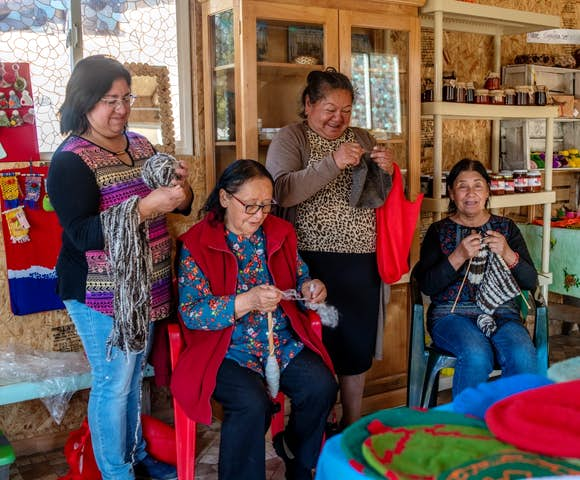 Local people weaving items at Mallin Colorado Lodge, Patagonia, Chile